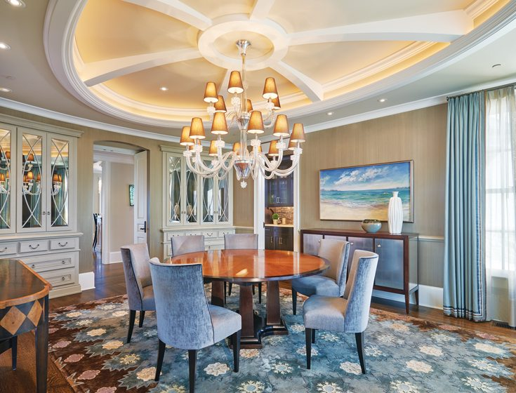 A Murano glass chandelier and floral rug set an elegant tone in the dining room.