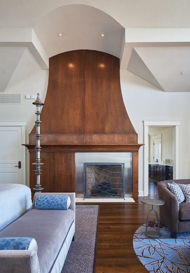 Susan Gulick Interiors designed the fireplace in walnut and stainless steel.