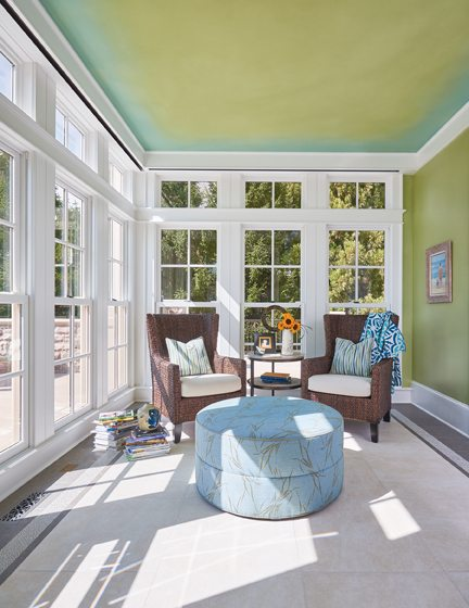 The tiled sunroom is a hangout for kids in wet swimsuits.