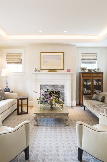 The fireplace in the living room was re-clad in Fantasy White marble.
