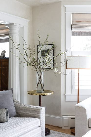 A Doric-style decorative column—one of six—anchors a corner of the living room.