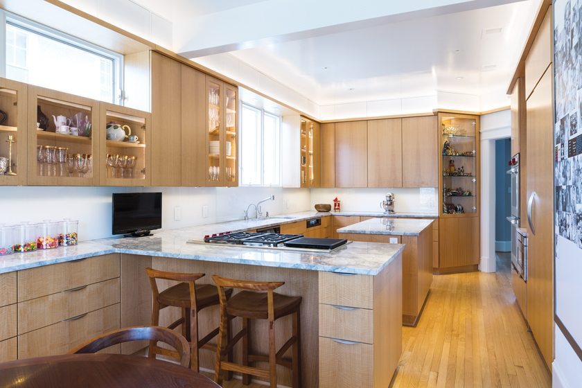 Ireland revamped the outdated kitchen with anigré cabinetry and marble countertops.