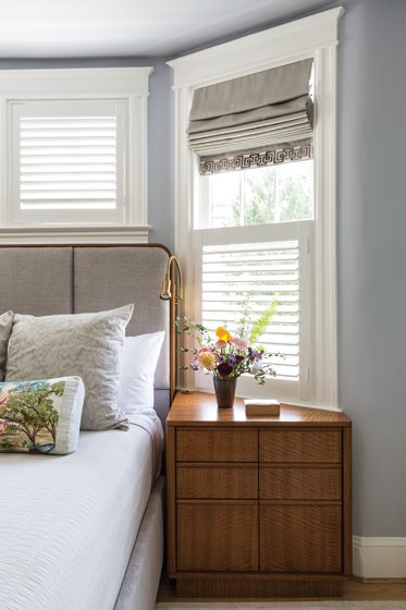 The custom bedroom furniture was designed to fit the bay window.