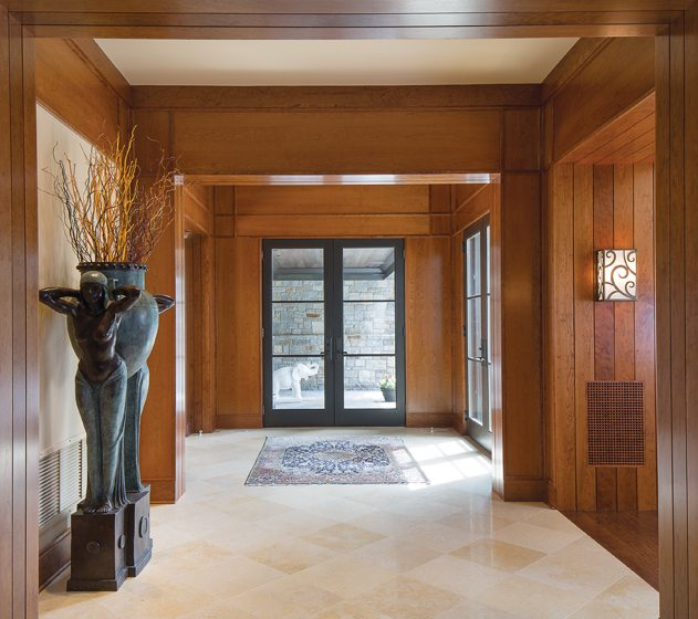 The wide entrance hall is paved in travertine.