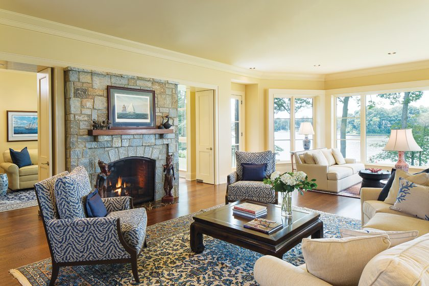 In the living room, the main seating area focuses on a double-sided gas fireplace.