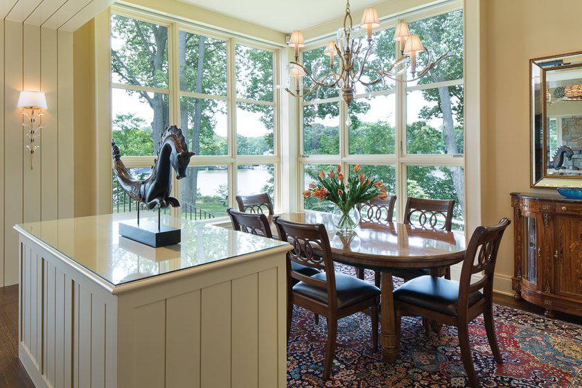 The dining area is sunken below the living area and kitchen for unobstructed water views.