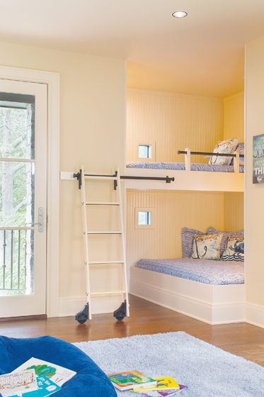 Over the garage, the bunk room with built-in beds accommodates visiting grandchildren.