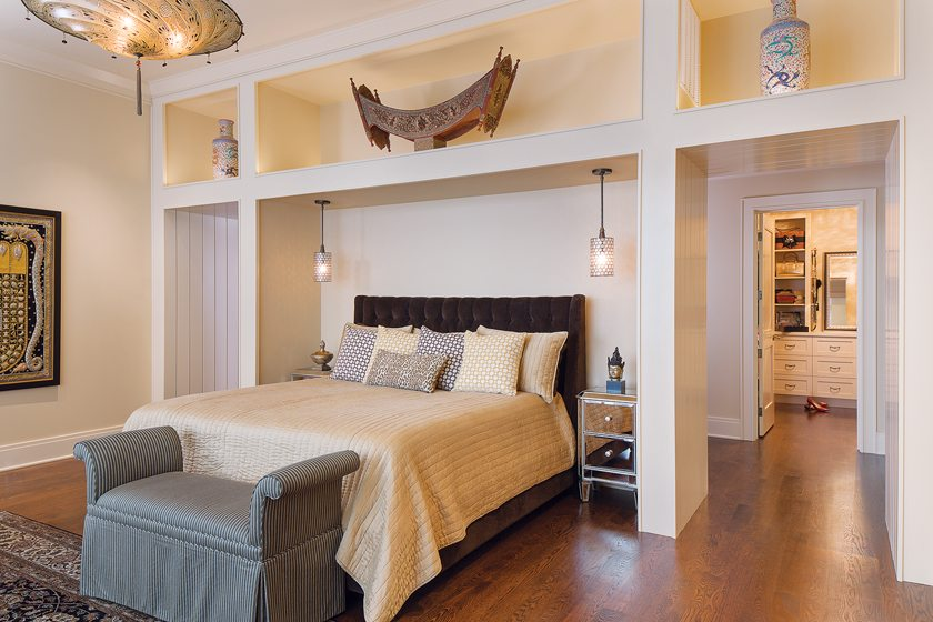Shelving in the master bedroom displays the homeowners' collection of Asian artifacts.
