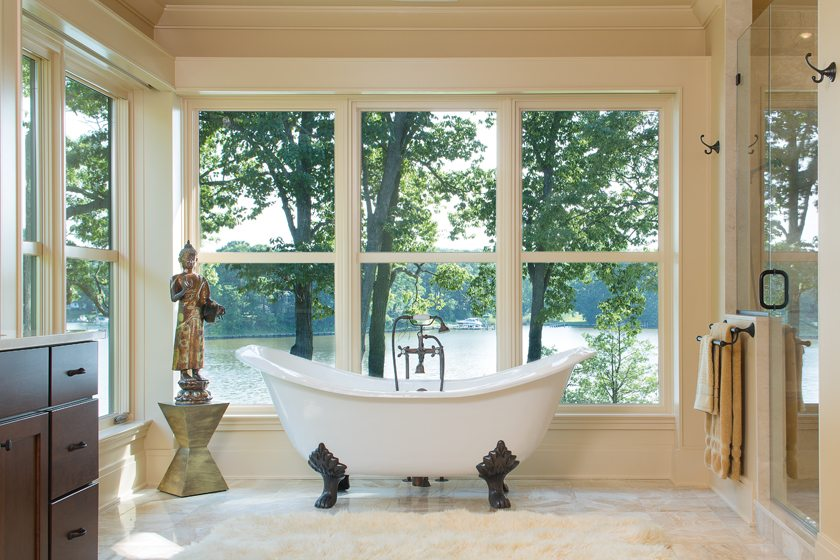 The claw-foot tub in the master bathroom provides a relaxing place to watch the creek through tall windows.