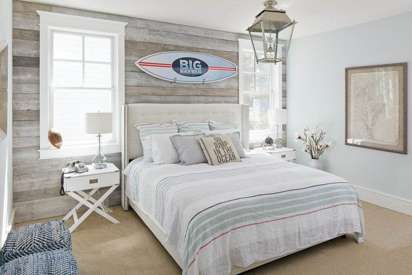 The surfboard adds beachy appeal to a guest bedroom.