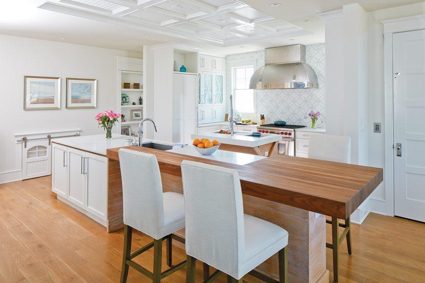 A mosaic backsplash from AKDO and a RangeCraft hood embellish the kitchen.