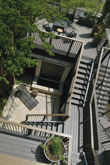 A deck was built atop the detached garage with new stairs to the terrace below.