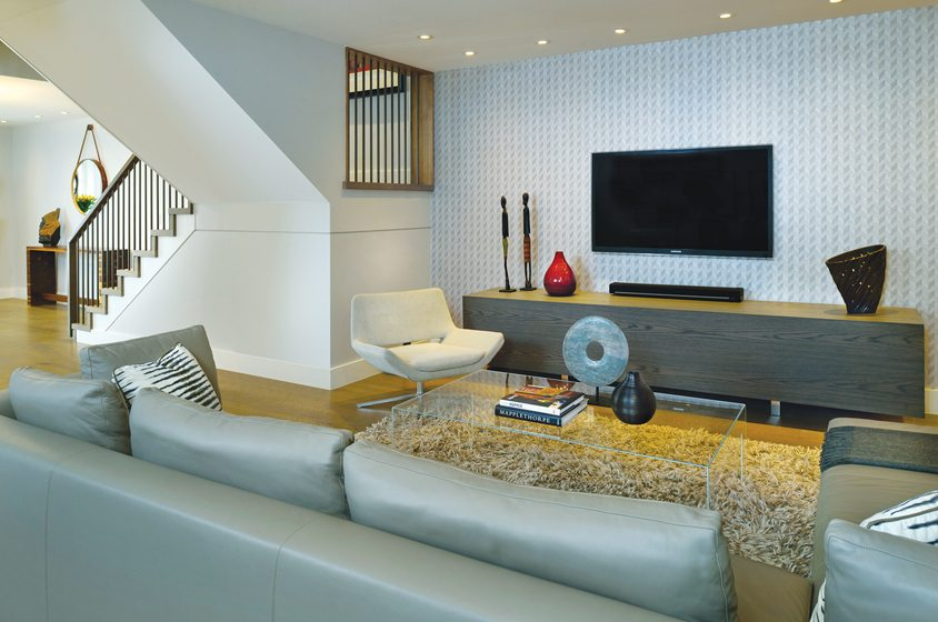 On the street level, the new family room lies beyond the refashioned foyer.