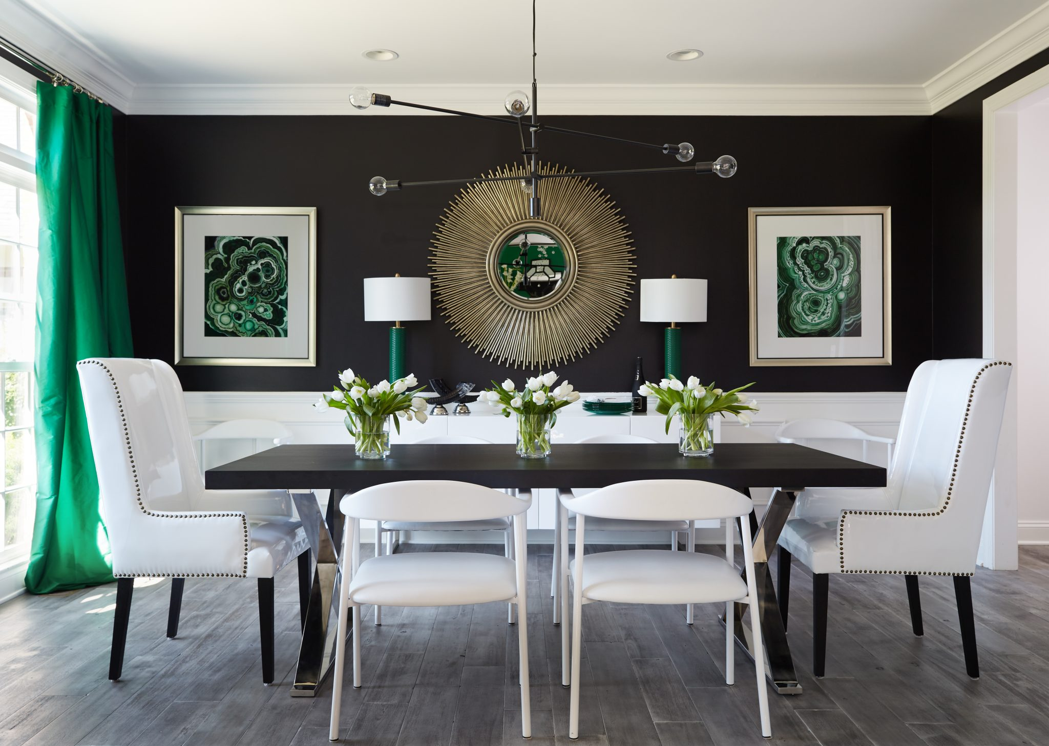 White furniture offers a strong contrast to black walls in the dining room.