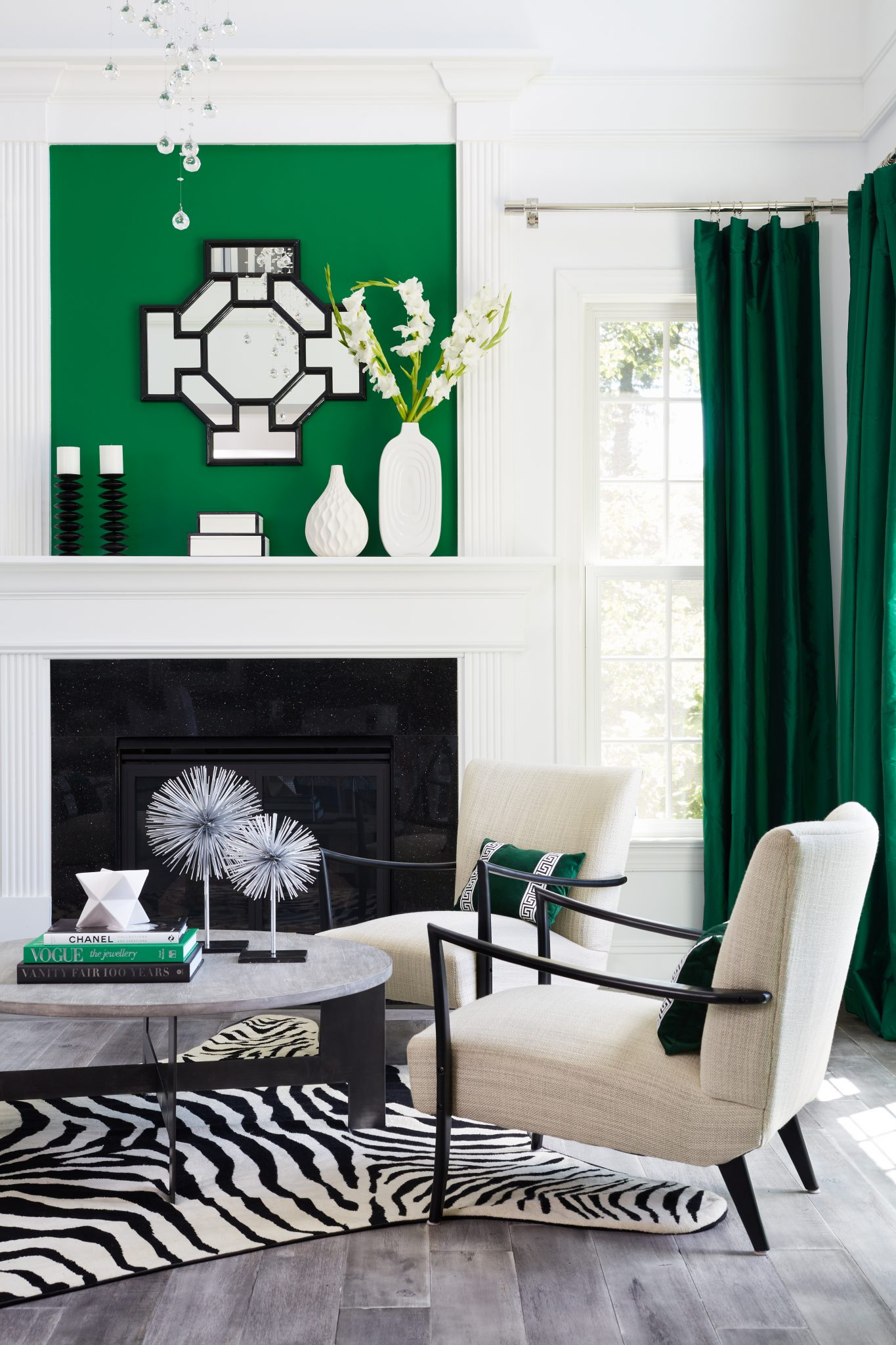 A panel painted in Sherwin Williams Green Belt adds a pop of color above the fireplace.