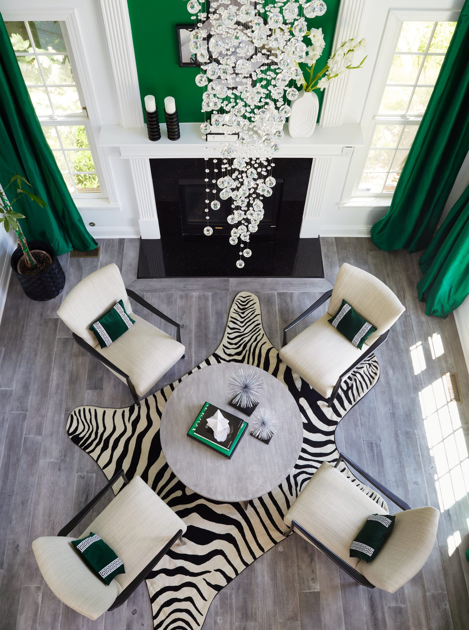 In the living room, a quartet of Effie chairs sits atop a faux-zebra hide.