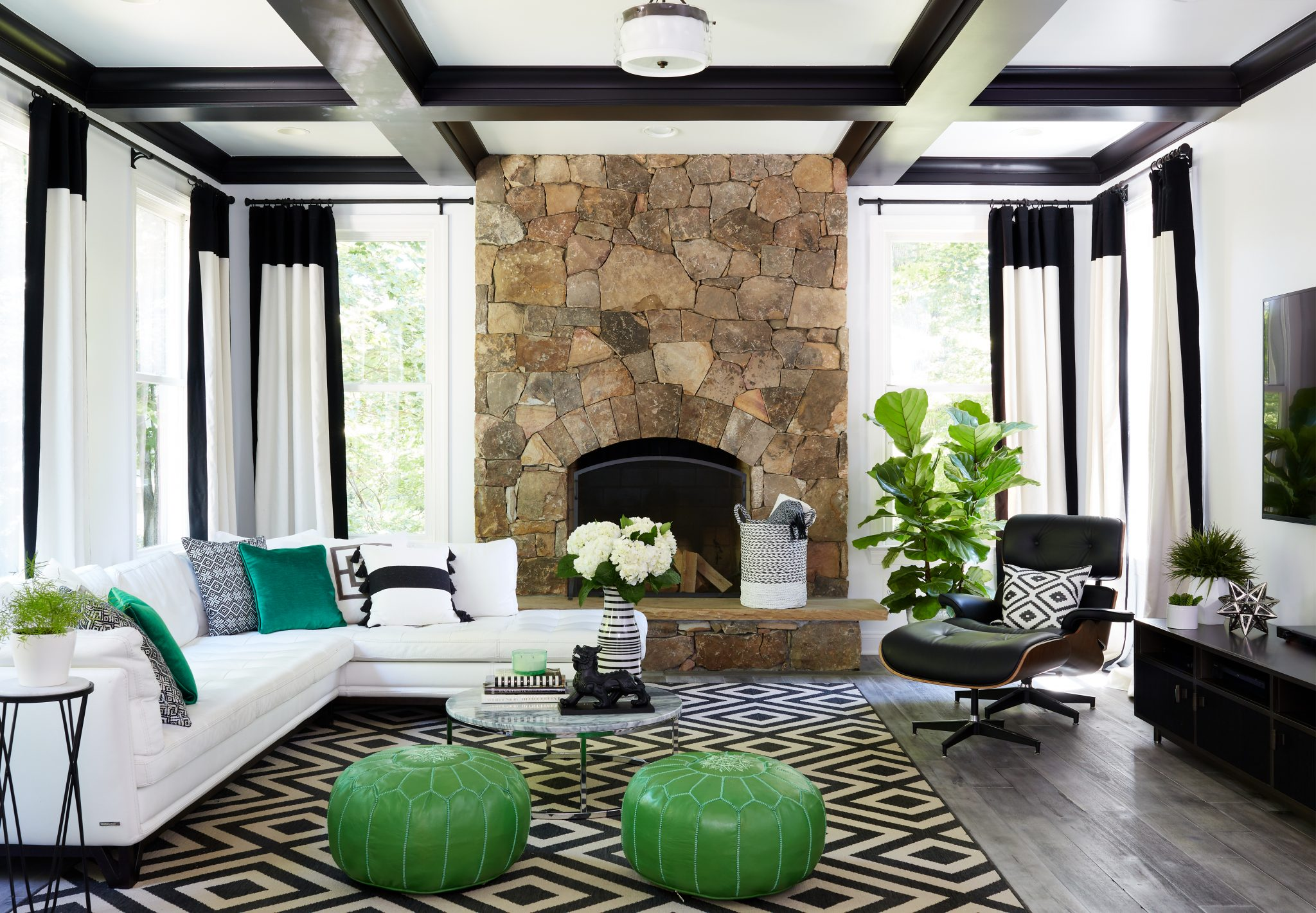 In the family room, a white sectional and geometric rug reinforce the black-and-white theme.