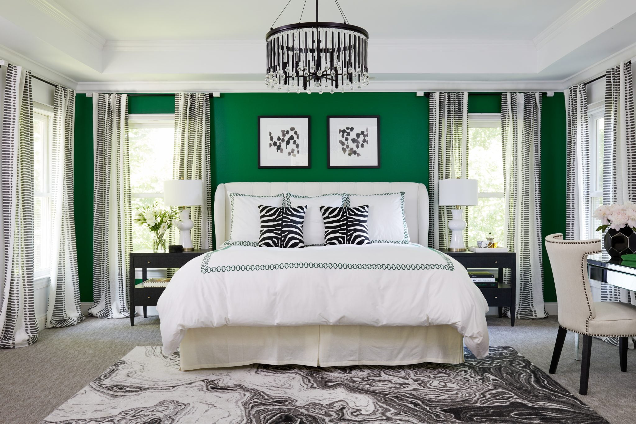 Serena & Lily bedding with emerald embroidery keeps the vibrant master bedroom balanced.
