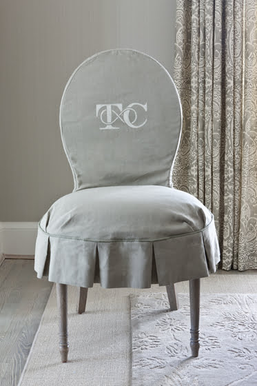 A monogram on a slipcovered chair.
