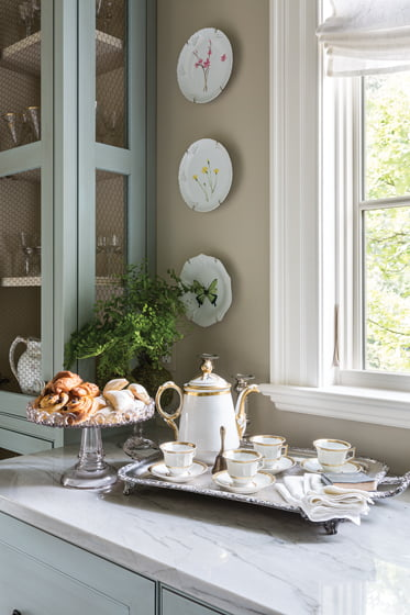 A tea set and napkins hand-painted by Billet Collins graced Nadia Subaran's pantry in the 2016 DC Design House.