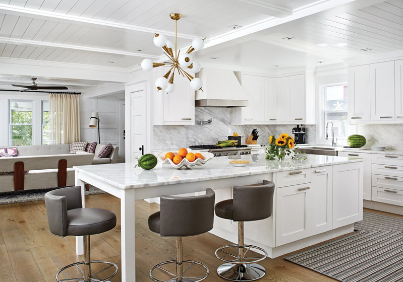 "White cabinetry and marble surfaces convey an ""updated traditional"" look."