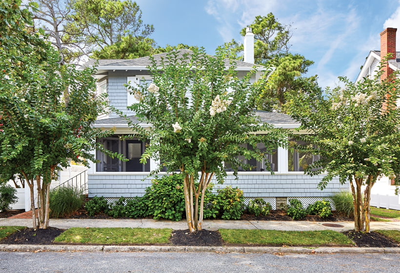 Brown Davis repainted the historic home's shingles a pale gray and added crisp, white shutters.