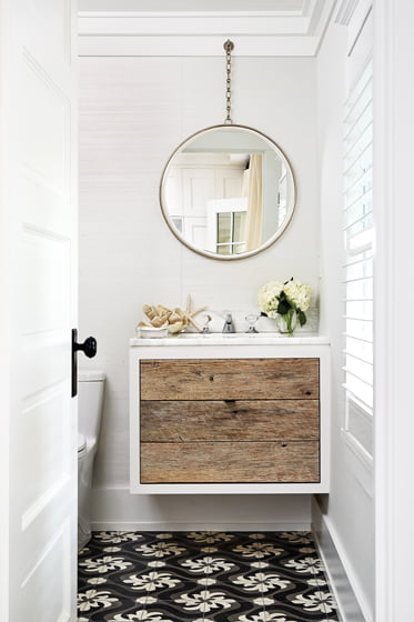 The powder room features a custom vanity with a driftwood front.
