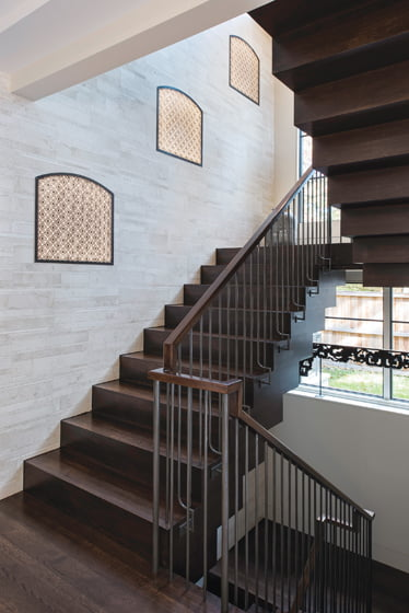 Sachs designed back-lit screens that create Moorish-style niches in the limestone-clad stairwell.