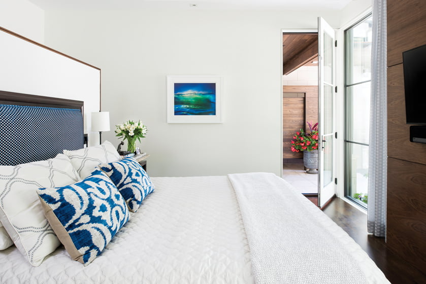 The master suite epitomizes relaxed, indoor/outdoor living with a door opening onto the pool terrace.