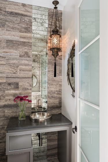 The powder room contains a sculptural, modern vanity.