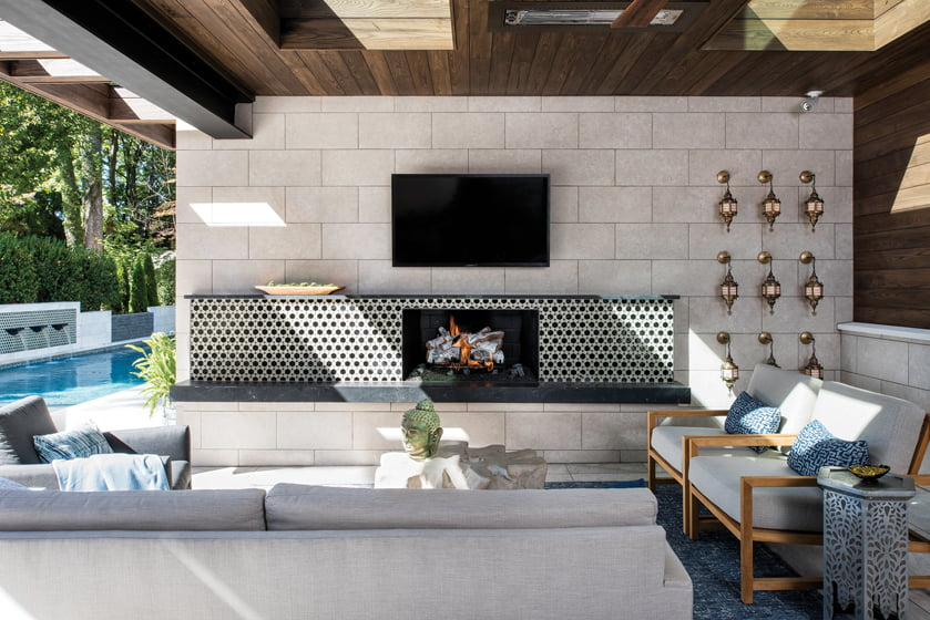 Century sofas and chairs in Sunbrella fabric surround a mantel of Sachs' design.