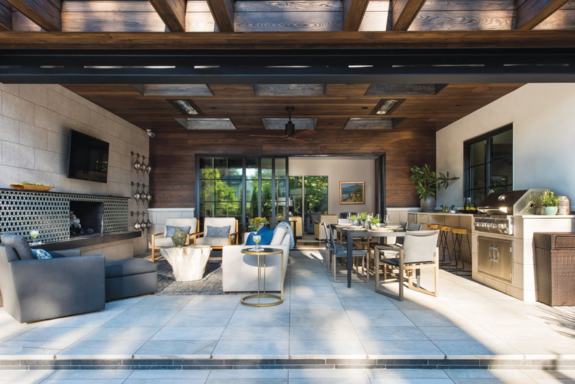 From the family room, guests spill through a stacking Loewen door onto the covered porch.