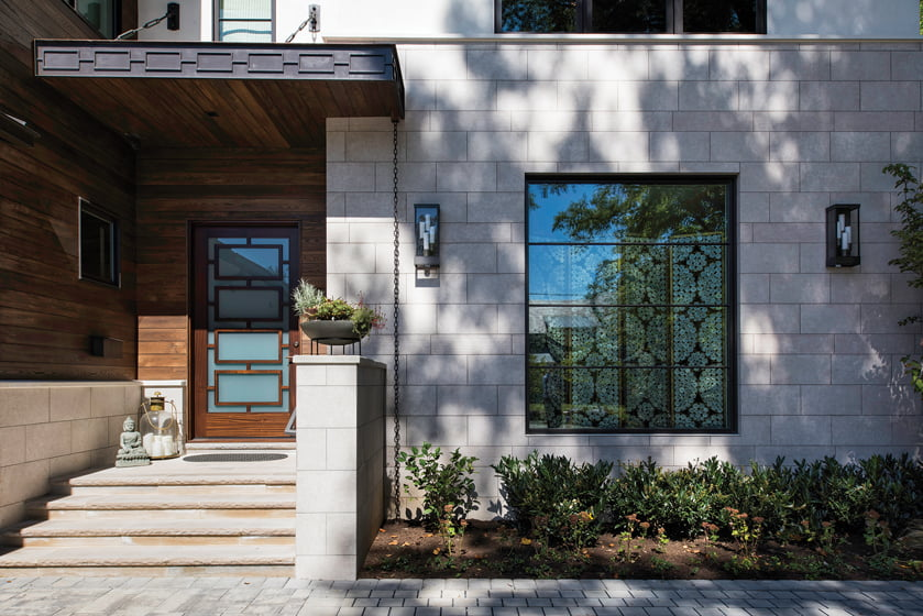 Sachs greets guests with considered details, from the wooden front door to the metal canopy above it.