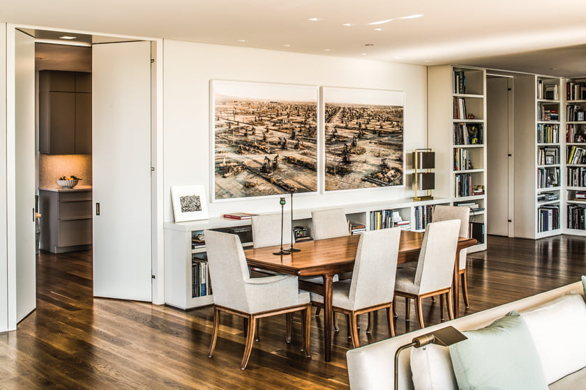 Built-in shelving in the dining area accommodates the owner's extensive library of art books.