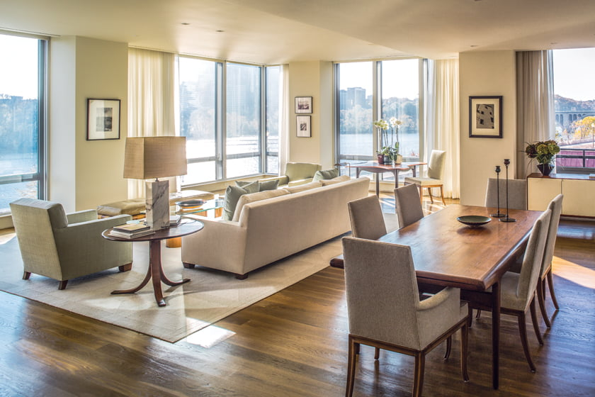 Muse Architects remodeled the riverfront condo to create an open living/dining room.