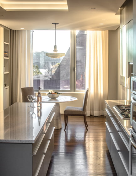The kitchen incorporates Poggenpohl cabinets, quartz countertops and a breakfast nook.