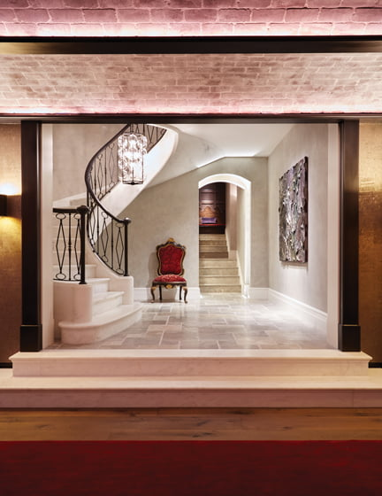 The lower-level landing leads to the powder rooms and the whiskey/wine cellar.