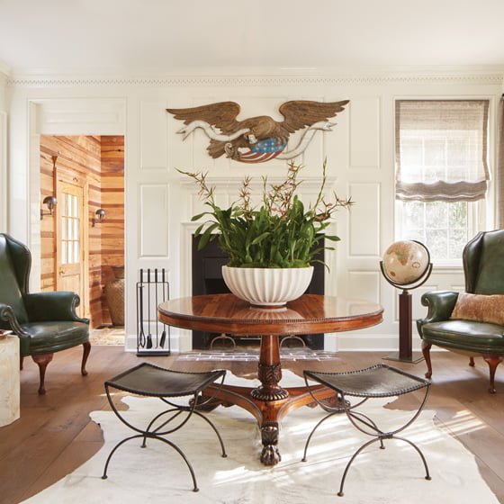 Touches of Americana include the antique, cast-iron eagle hovering above the parlor fireplace.