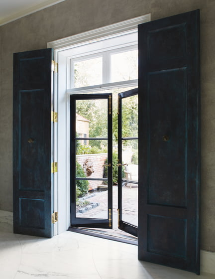 French doors outside the entertaining space enhance lawn-party flow.