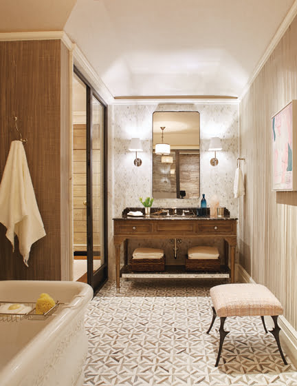The wife's bathroom marries a cerused-oak vanity with a floor from Marble Systems.