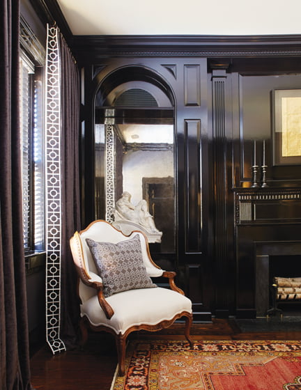 Glossy black paint highlights the new millwork and updates the existing fireplace.