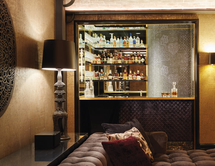 A mirrored backdrop creates the illusion of space in the diminutive bar.