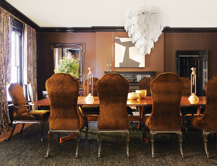 The dining room's Great Plains silk wall covering and Casamance crushed-velvet drapes envelop guests in warmth.