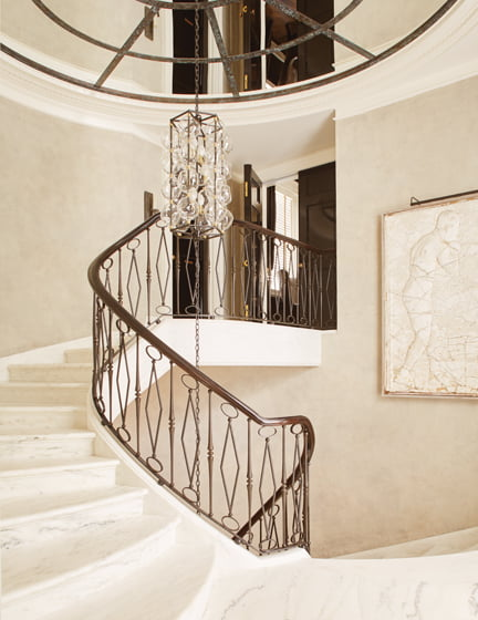 A wrought-iron handrail of Sutton's design graces the new marble staircase.