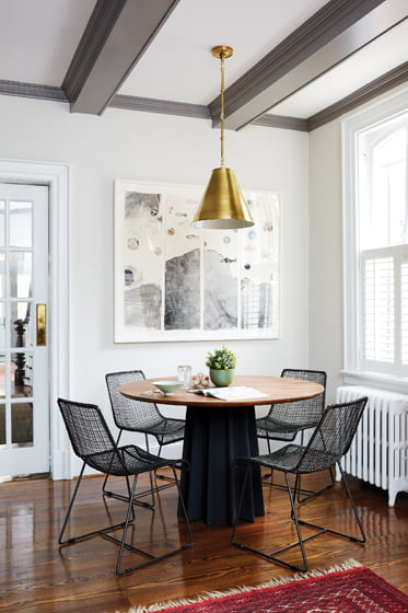 The breakfast nook holds a CB2 table and chairs.