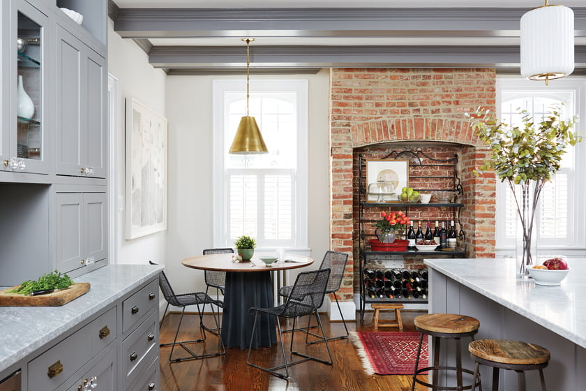 An exposed-brick niche—formerly a fireplace—now houses a wine rack.
