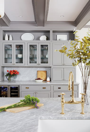 A wall of cabinetry provides storage.