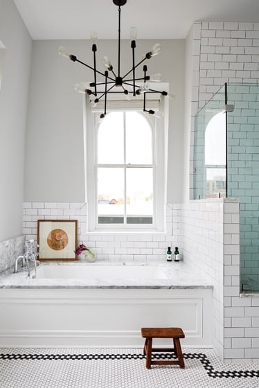 An industrial-style light from Restoration Hardware imparts an urban edge to the third-floor bath.