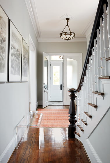 The airy front hall leads back to the kitchen.