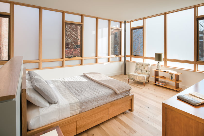 Transparent and translucent windows by Loewen maximize light and privacy in the bedroom.